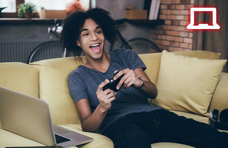 Stream Right Away. A teenager is playing console game on a couch and using LGP2 to capture his gameplay.